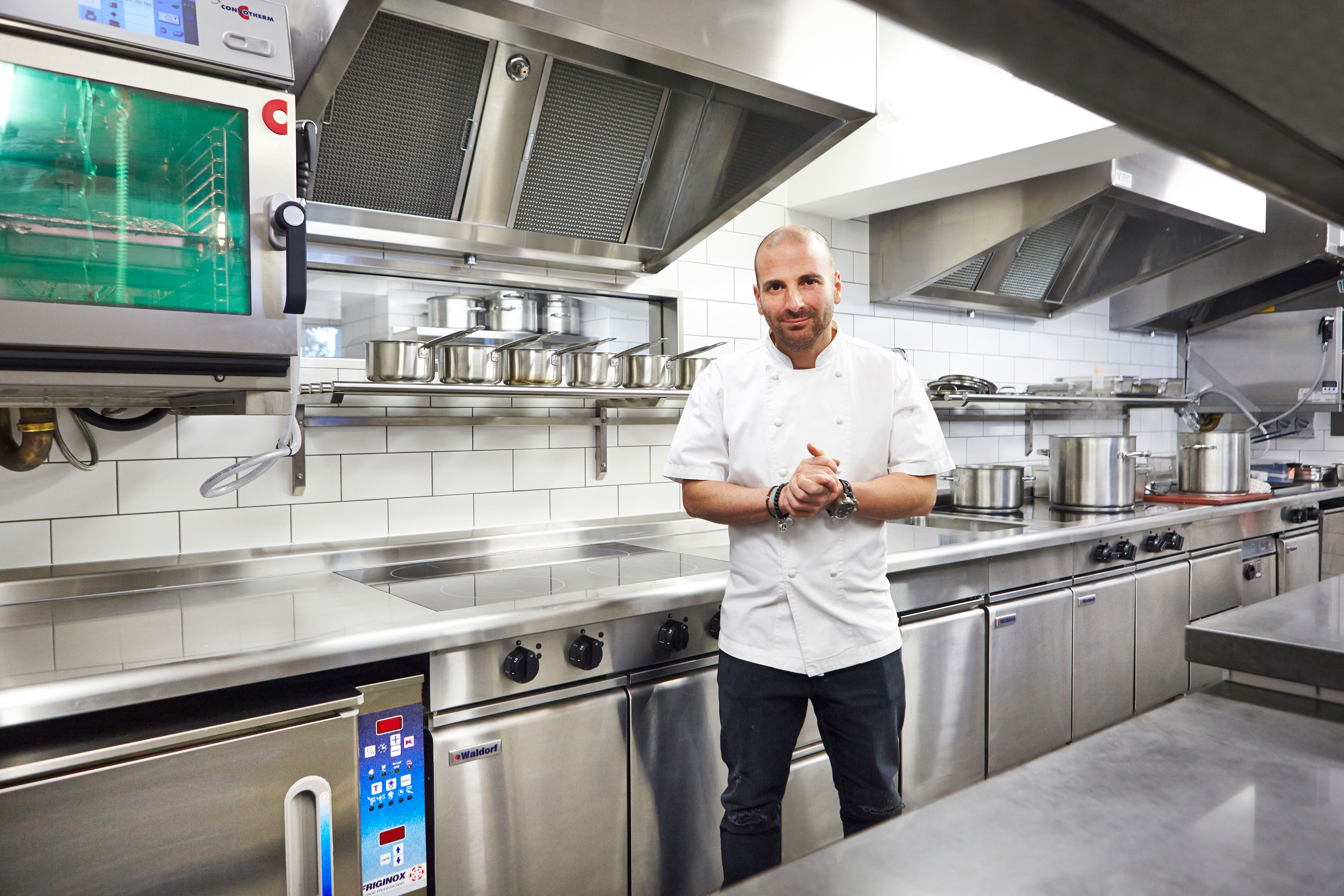 The equipment range includes two Waldorf Bold 4-zone induction cooktops and a Waldorf twin pan commercial deep fryer.