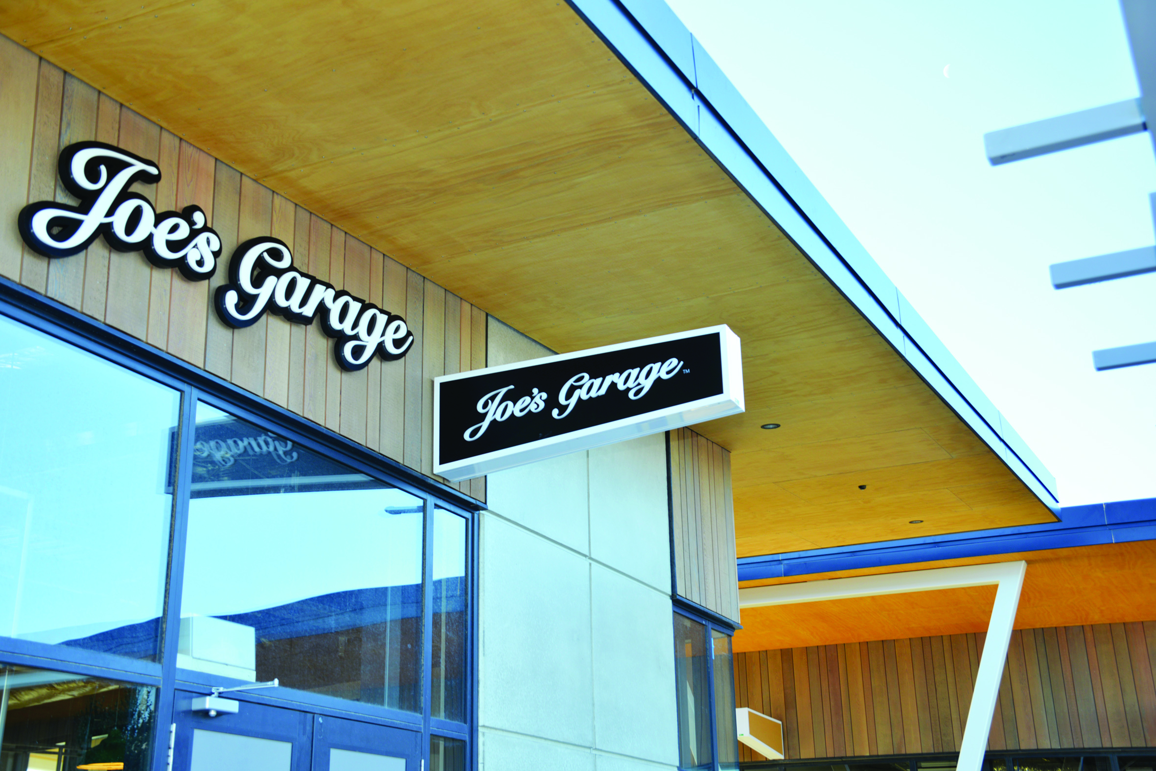 After seaside success with Joe's Garage in Sumner owner Anton Matthews looked to take the popular café to new heights with his next project.
